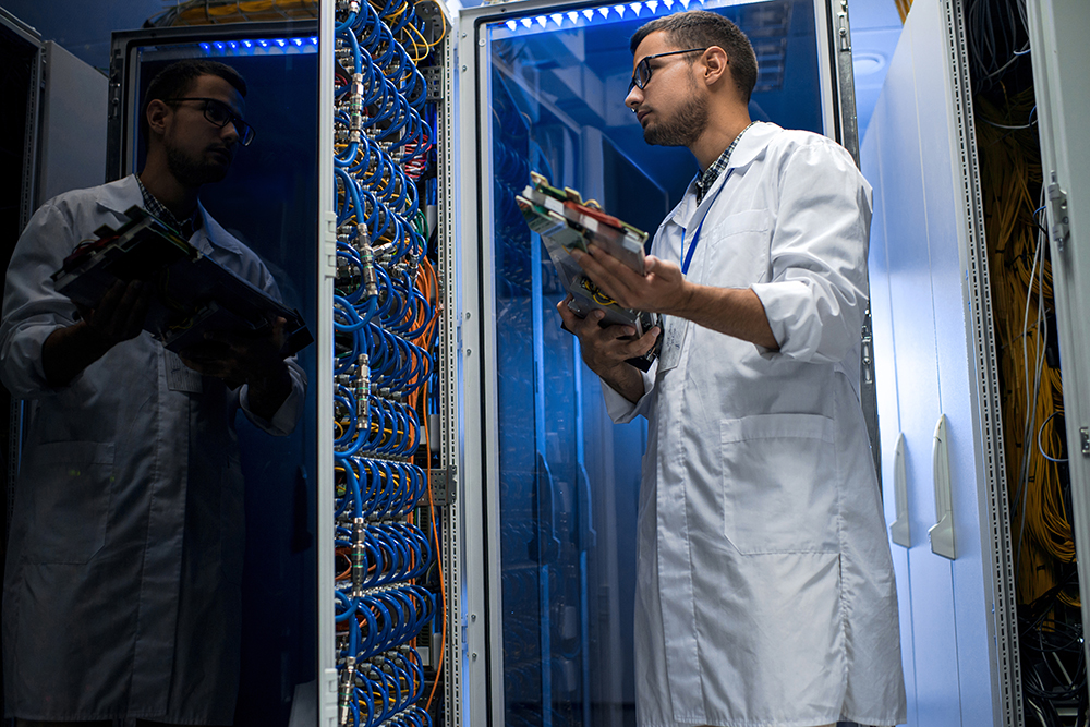 Young Technician Working with Supercomputer